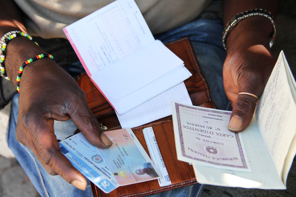 Migrants and refugees carry their documents regularly as they are stopped by police and asked to show their permit of stay.